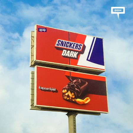 Cairo's billboards invite you to use Snickers Dark before it disappears